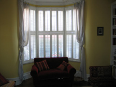 Tier on tier, bifold shutters with 47mm louvres Islington