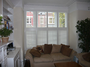 Tier on tier style shutters with 63mm louvres Highgate