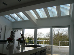 Roof shutters for shade in this kitchen overlooking Hampstead Heath