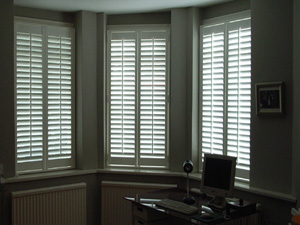 Full height shutters in this lower ground floor flat for privacy and perceived security Highgate