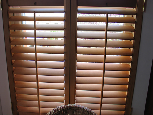 Oiled Western Red Cedar shutters with 63mm louvres.