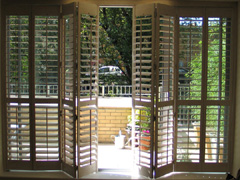 patio door shutters on a tracking system Hackney