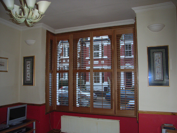Attractive and efficient. Oiled Western Red Cedar shutters with 63mm louvres positioned above the convection radiator.