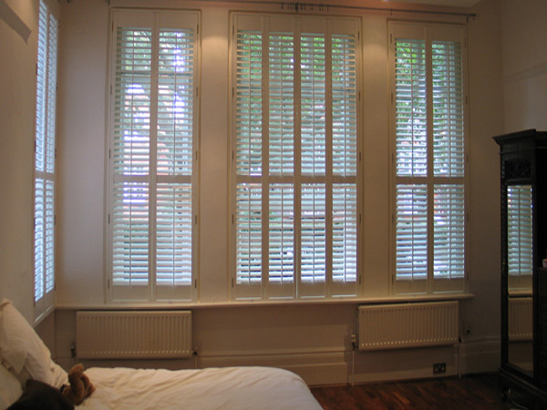 MDF shutters. Tall and narrow suits MDF with lots of hinges to carry the weight