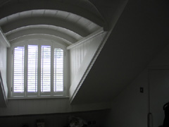 arched shutters with offset tilt rods Islington