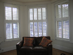 Silk white tier on tier shutters with 63mm louvres fitted in Muswell Hill, North London