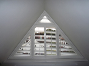63mm silk white triangular shaped shutters Tufnell Park