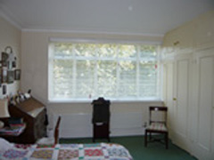 Three white 50mm slatted wood blinds Hampstead