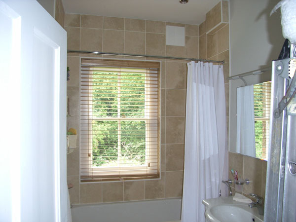 50mm Canadian Maple wood slat venetian fitted in a bath and shower area.
