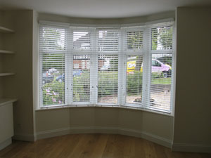 White wood slat venetian blinds fitted Parliament Hill North London