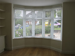 50mm white woodslats in bay window Hampstead